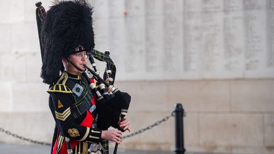 Belgian piper Gil Vermeulen plays the pipes during the Last Post ceremony at the Commonwealth War Graves Commission Ypres…