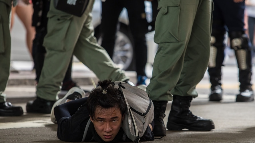 -- AFP PICTURES OF THE YEAR 2020 --  Riot police detain a man as they clear protesters taking part in a rally against a new…