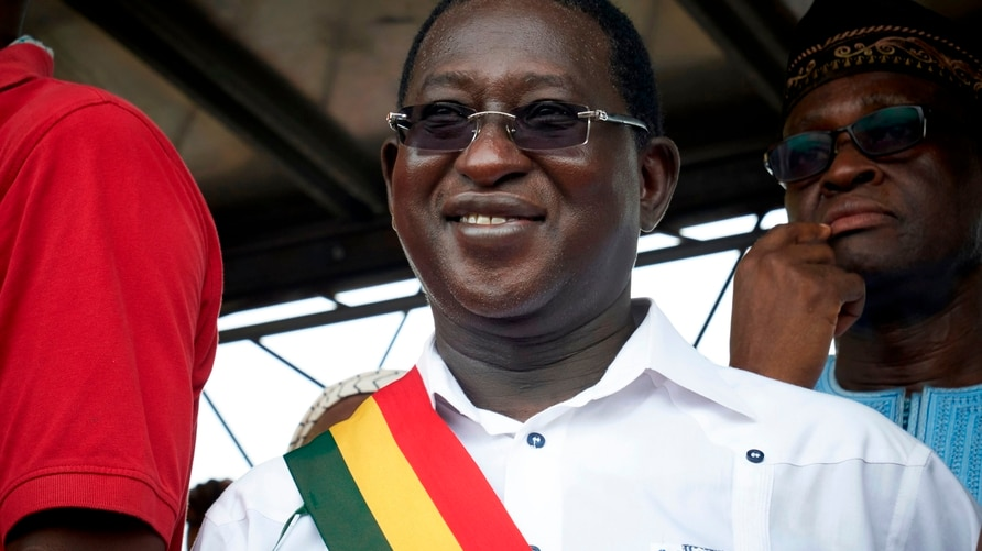 (FILES) In this file photo taken on August 18, 2018 Malian Opposition leader Soumaila Cisse (C) waves to his supporters during…
