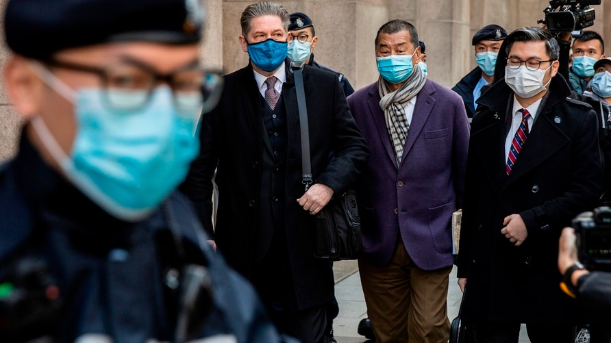 Hong Kong pro-democracy media tycoon Jimmy Lai (centre R) leaves the Court of Final Appeal in Hong Kong on December 31, 2020,…