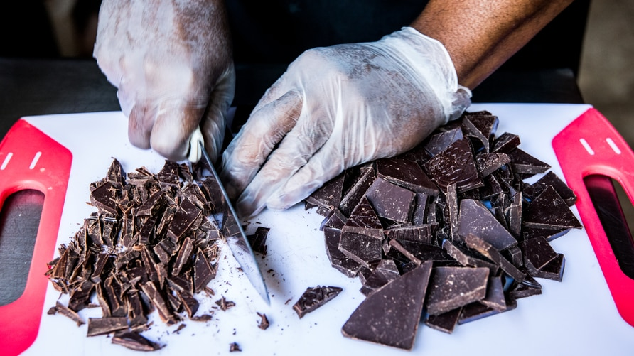 Preparation of a chocolate ganache with local rum by chocolate maker Ralph Leroy in the workshops of Makaya Chocolat on…
