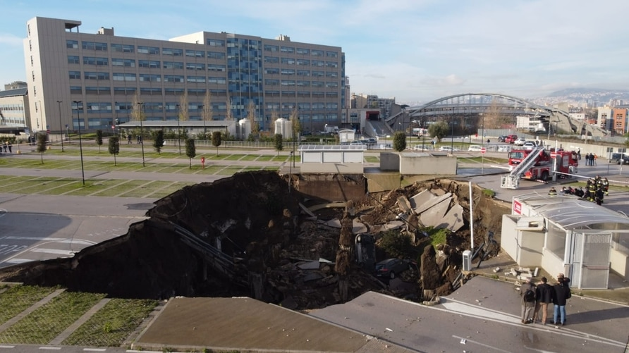 A aerial view shows a sinkhole in the Ospedale del Mare hospital car park, where people come for Covid-19 testing, on the…