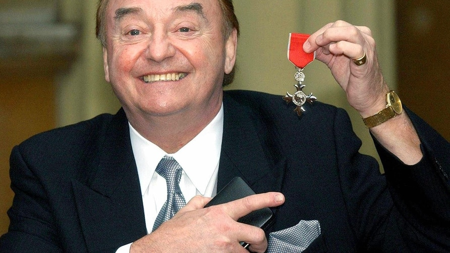 (FILES) In this file photo taken on December 12, 2003, sixties singing sensation Gerry Marsden, from Liverpool, poses with his…