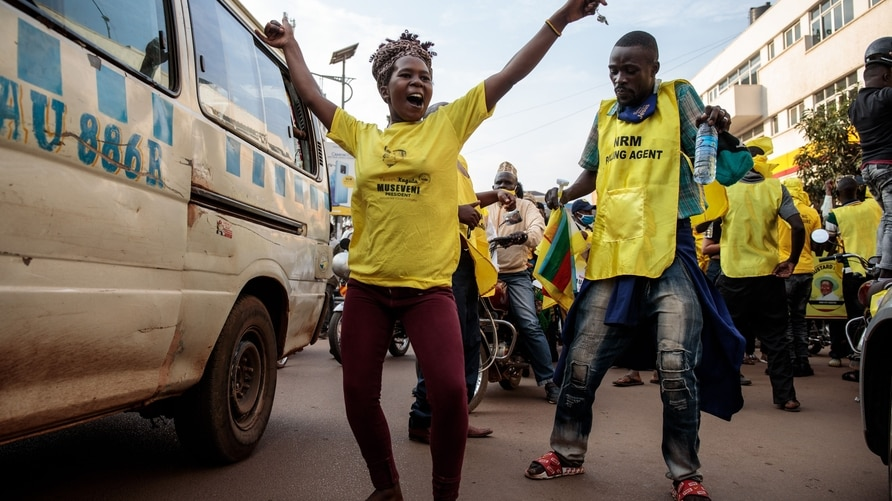 Supporters of the National Resistance Movement (NRM) celebrate the victory of President Yoweri Museveni after the results of…