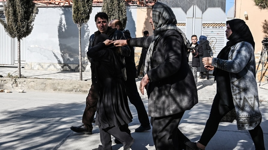 Relatives of the victims arrives at the site following gunmen shot dead two Afghan women judges working for the Supreme Court,…