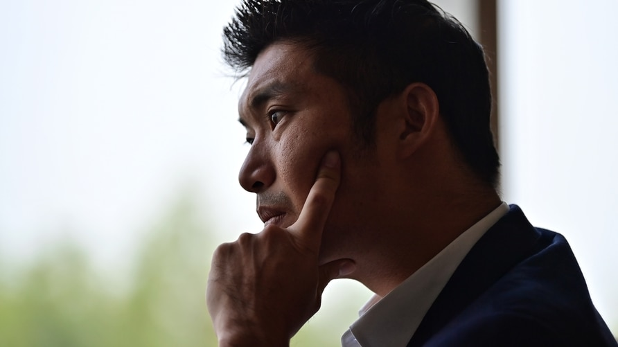 Thanathorn Juangroongruangkit, founder of the now-dissolved Future Forward Party, listens during an interview in Bangkok on…