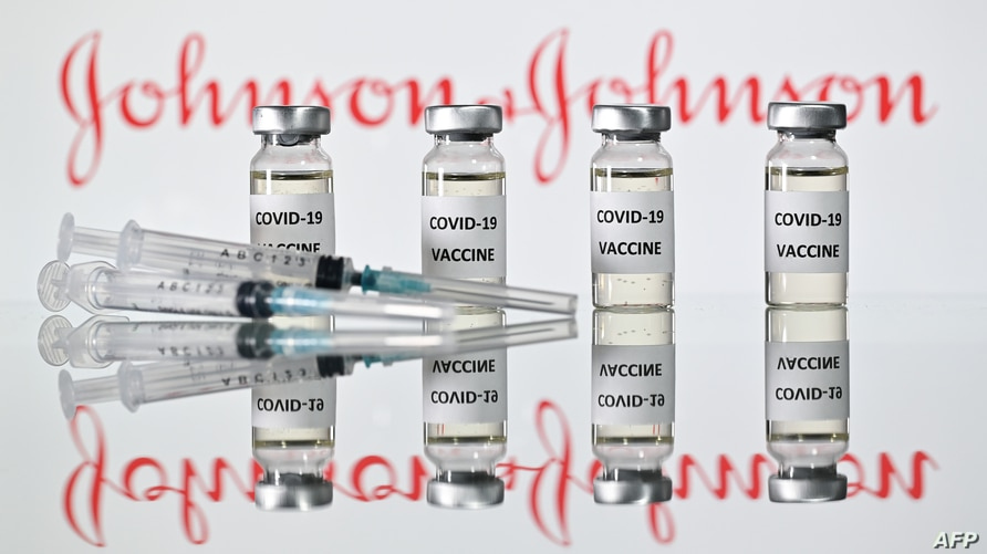 (FILES) This file illustration photo taken on November 17, 2020 shows vials with Covid-19 Vaccine stickers attached and…