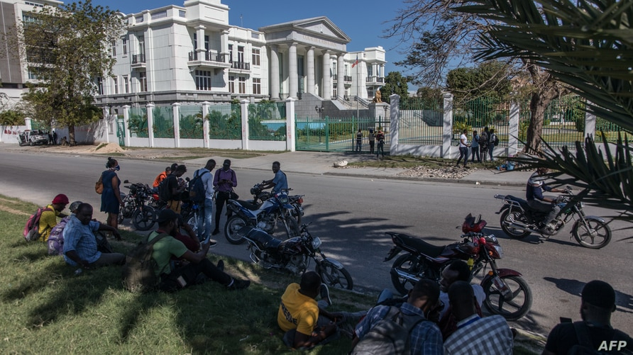 Journalists gather outside the Supreme Court of Haiti (Cours de cassation)on February 8, 2021 in the almost empty streets of…