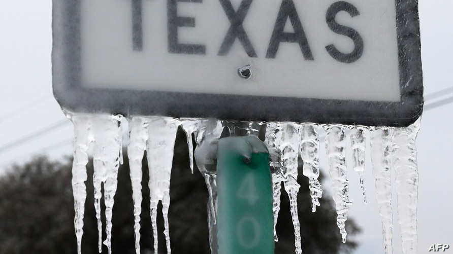 KILLEEN, TEXAS - FEBRUARY 18: Icicles hang off the State Highway 195 sign on February 18, 2021 in Killeen, Texas. Winter storm…