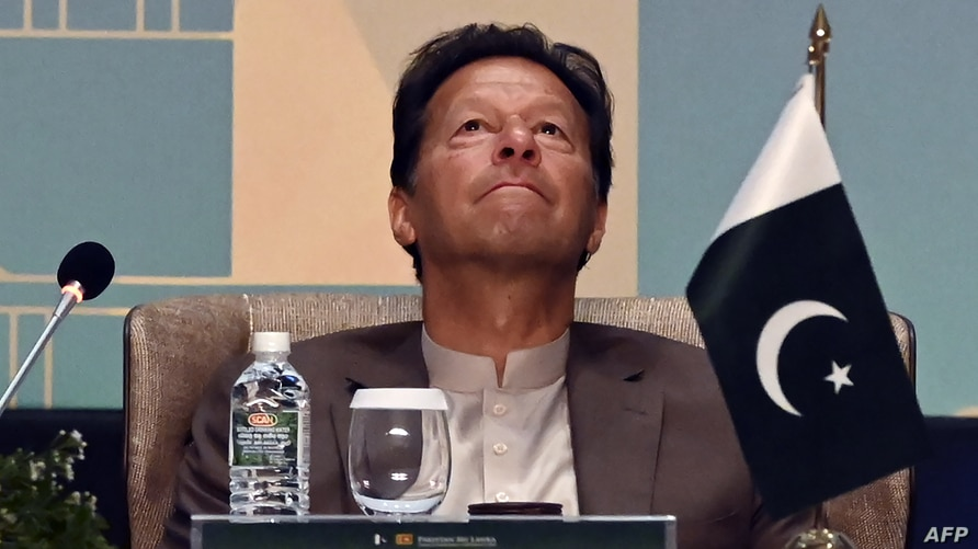 Pakistan's Prime Minister Imran Khan looks on during a Trade and Investments conference in Colombo on February 24, 2021 on the…