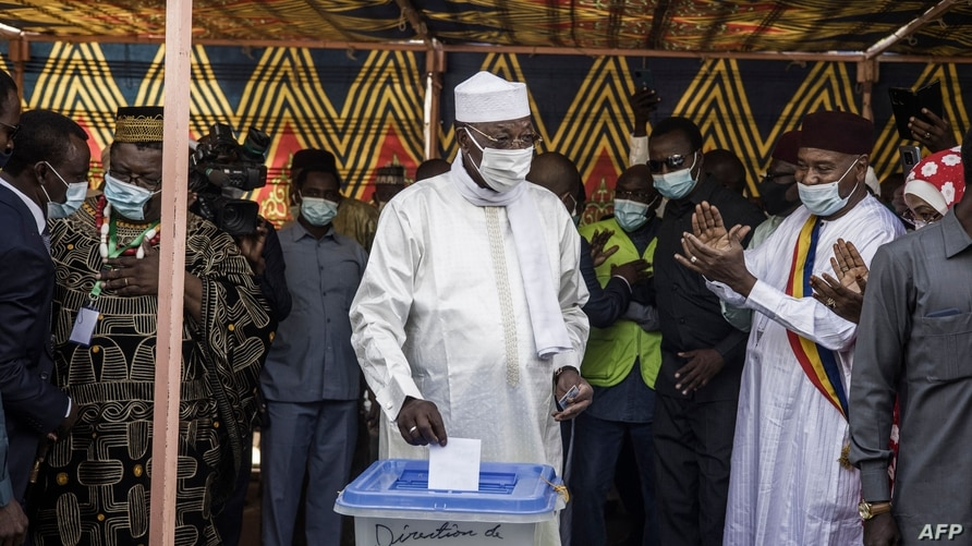 Chadian President Idriss Deby Itno (C) casts his ballot at a polling station in N'djamena, on April 11, 2021. - Chad headed…