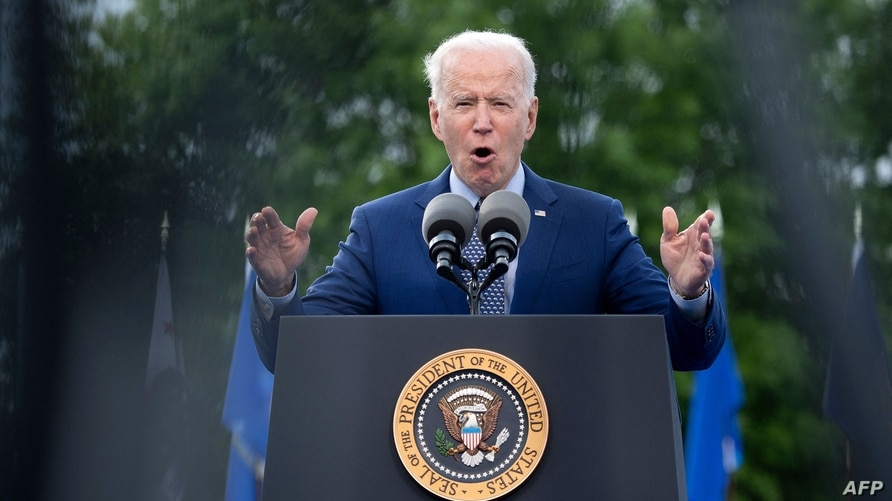 US President Joe Biden speaks during a drive-in rally at Infinite Energy Center April 29, 2021, in Duluth, Georgia. (Photo by…