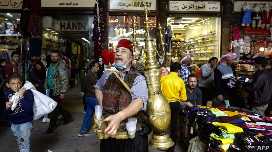 Ishaaq Kremed, a tamarind juice seller, calls on customers in the covered Hamidiyah market in the old part of the capital…