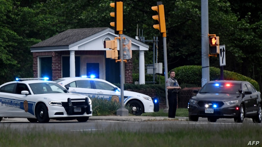 Police cars are seen outside the CIA headquarters's gate after an attempted intrusion earlier in the day in Langley, Virginia,…