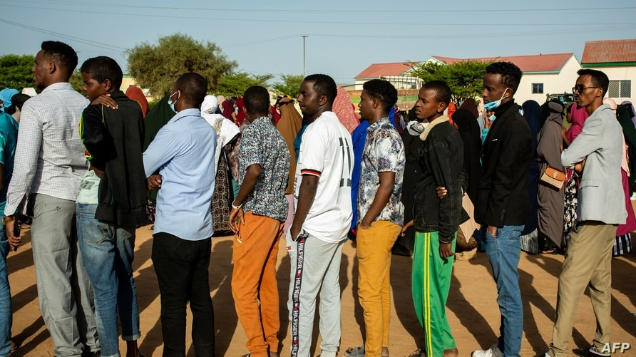 Men  queue to vote for Somaliland's elections at a polling station in Gabiley, Somaliland, the self-declared republic of…