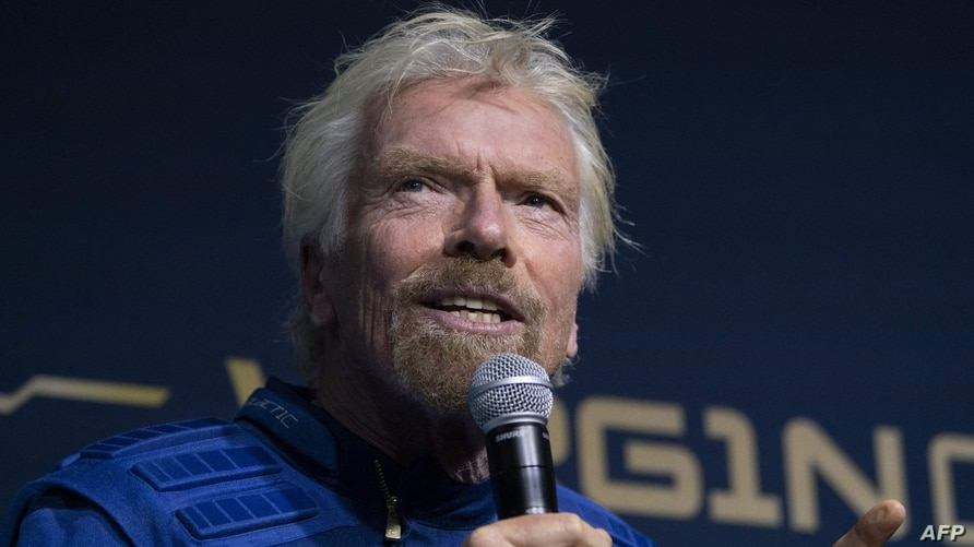 (FILES) In this file photo taken on October 16, 2019 Virgin Group founder Sir Richard Branson speaks at an event to unveil the…