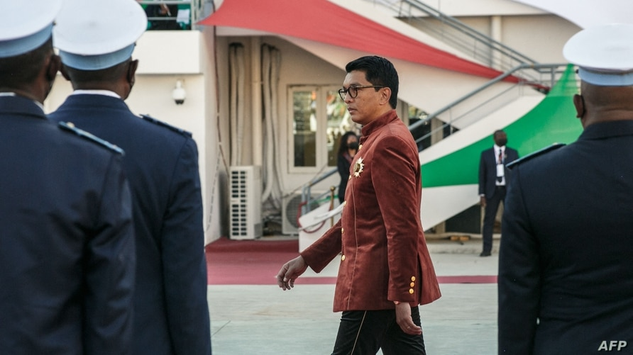 (FILES) In this file photograph taken on June 26, 2021, Madagascar's President Andry Rajoelina inspects troops during…