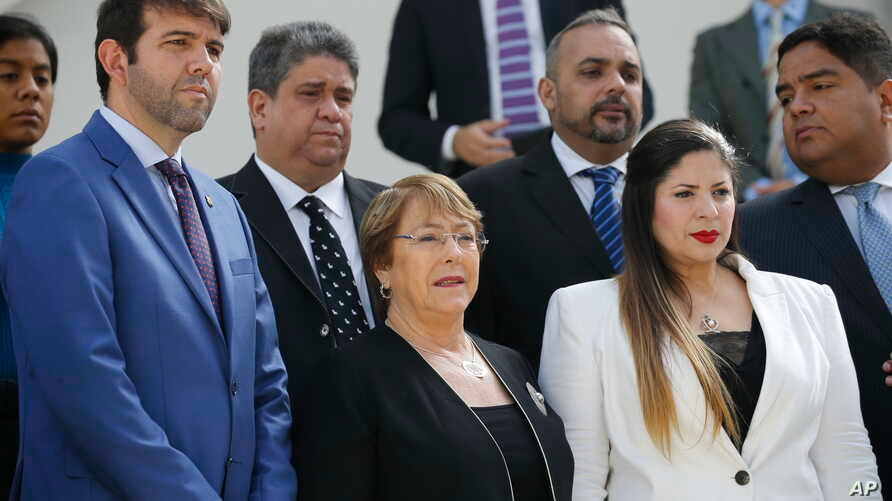 U.N. High Commissioner for Human Rights Michelle Bachelet poses for a photo with opposition lawmakers on the steps of the national assembly in Caracas, Venezuela, Friday, June 21, 2019.