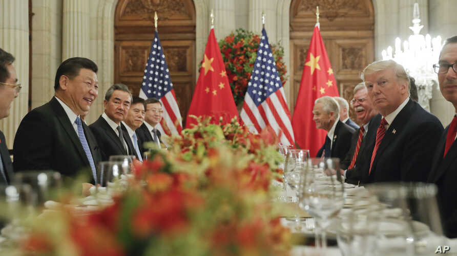 FILE - In this Dec. 1, 2018, photo, President Donald Trump, second from right, meets with China's President Xi Jinping, second from left, during their bilateral meeting at the G20 Summit, in Buenos Aires, Argentina.