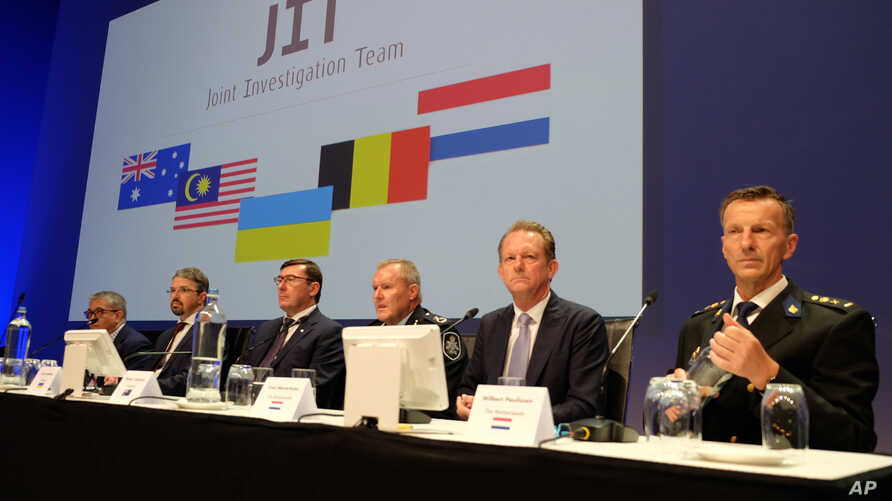 Officials from the Joint Investigation Team probing the downing of Malaysia Airlines Flight 17 in 2014 appear at a press conference in Nieuwegein, Netherlands, on Wednesday, June 19, 2019. The international investigation team charged three Russians…