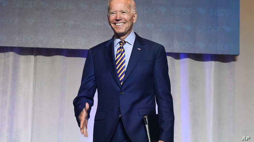 Former Vice President Joe Biden arrives on stage at the South Carolina Democratic Party convention, Saturday, June 22, 2019 in Columbia, S.C.. (AP Photo/Meg Kinnard)