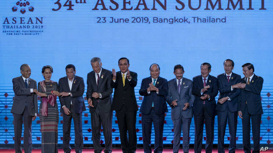 Leaders of the Association of Southeast Asian Nations (ASEAN) pose for a group photo during the opening ceremony of the ASEAN leaders summit in Bangkok, Thailand, June 23, 2019.