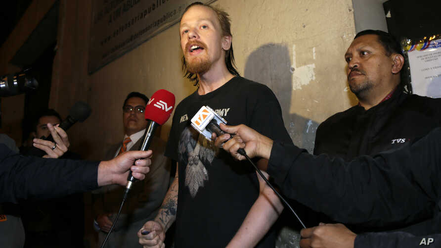 Swedish programmer Ola Bini talks to reporters after he was freed in Quito, Ecuador,  June 20, 2019. The Swedish programmer close to WikiLeaks founder Julian Assange had been held in jail for more than two months on suspicion of hacking.