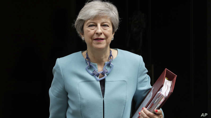 British Prime Minister Theresa May leaves 10 Downing Street in London, to attend Prime Minister's Questions at the Houses of Parliament, Wednesday, June 19, 2019. Britain's Conservative Party are set to kick one more candidate out of the contest to…