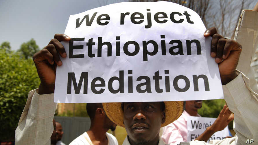 A Sudanese supporter of the military council, holds a placard during a sit-in against Ethiopian mediation, outside the Ethiopian embassy, in Khartoum, Sudan, June 25, 2019.