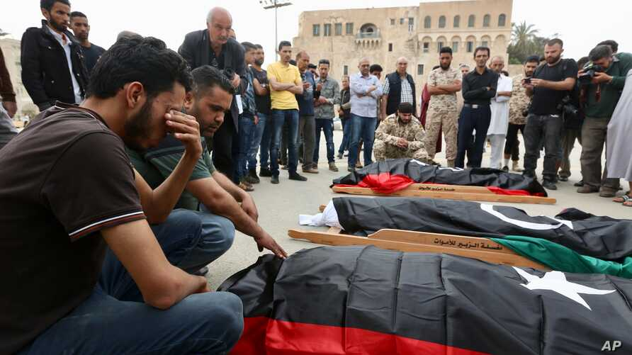Mourners gather for funeral prayers for fighters killed by warplanes of Field Marshal Khalifa Hifter's forces, Wednesday, April 24, 2019 in Tripoli, Libya.
