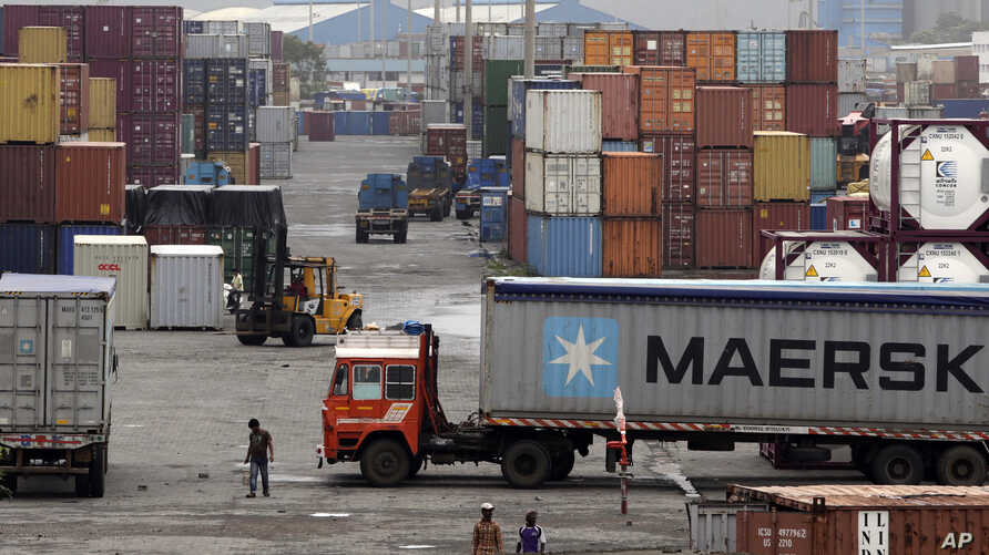 FILE - Containers are piled up at a terminal at the Jawaharlal Nehru Port Trust in Mumbai, India, June 29, 2017. India's commerce ministry says it will not try to hold onto its preferential zero-tariffs status with the United States after Washington decided to drop it from its Generalized System of Preferences program.