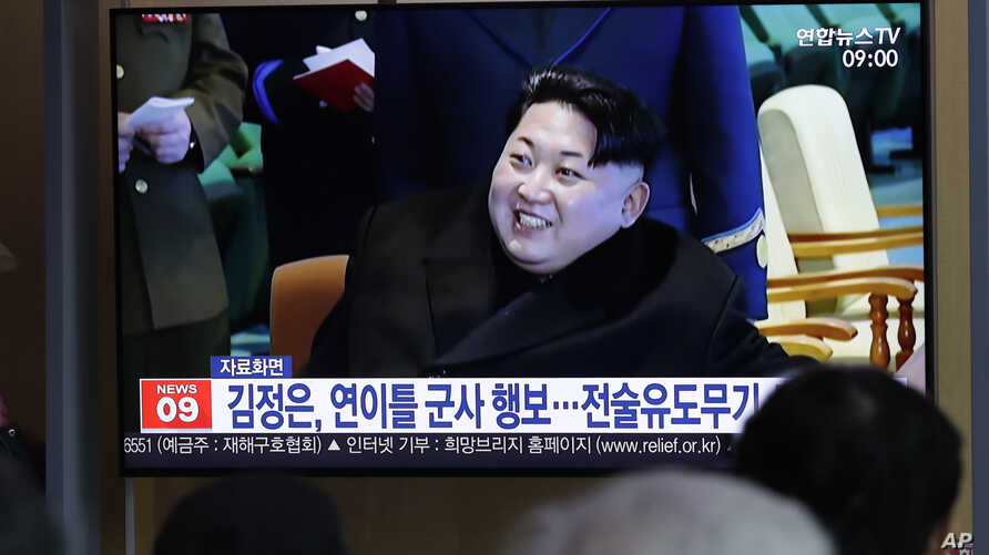 """People watch a TV news program reporting about North Korea's test-fire of a """"new-type tactical guided weapon,"""" with a file footage of North Korean leader Kim Jong Un, at the Seoul Railway Station in Seoul, South Korea, Thursday, April 18, 2019…"""