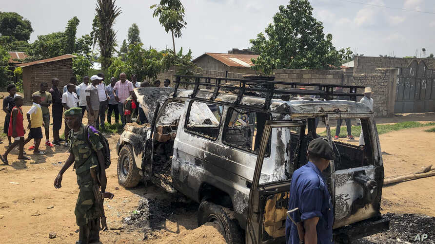 Congolese security forces attend the scene after the vehicle of a health ministry Ebola response team was attacked in Beni, northeastern Congo Monday, June 24, 2019. A driver working with the team is in critical condition after angry crowds hurled…