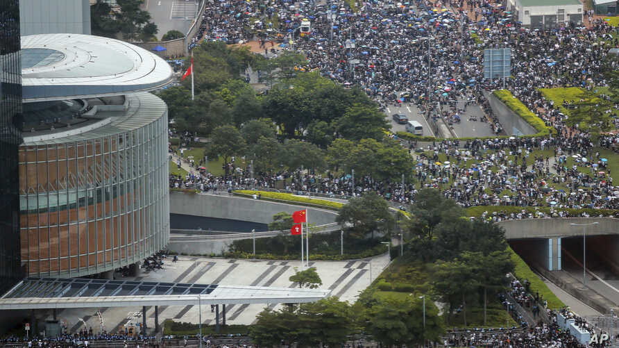 Protesters gather outside the Legislative Council in Hong Kong, Wednesday, June 12, 2019.