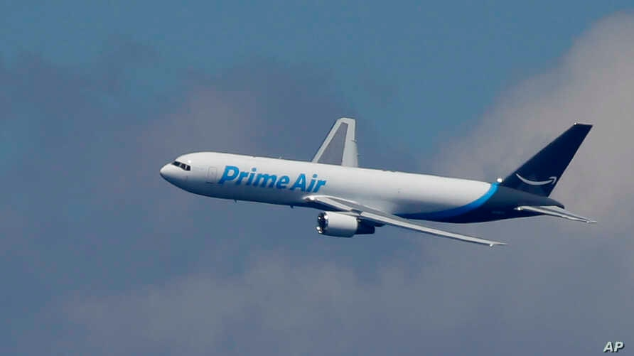 "FILE - A Boeing 767 with an Amazon.com ""Prime Air"" livery flies over Lake Washington.   The online retailer says it will lease 10 Boeing 767s planes, which will bring its total aircraft fleet up to 50. Amazon has…"