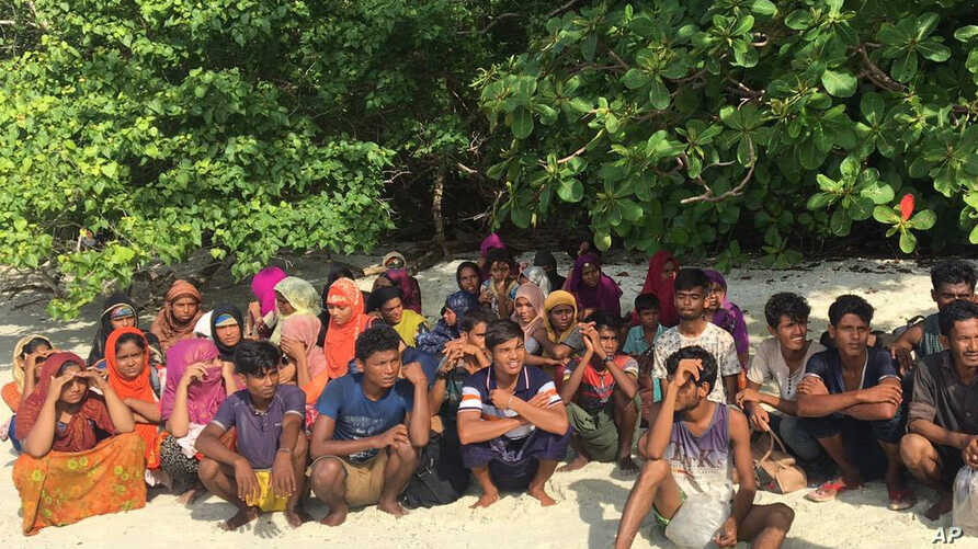FILE - Rohingya sits on a beach at Rawi island in Satun province Southern of Thailand Tuesday, June 11, 2019. Thai officials say they have discovered 65 ethnic Rohingya Muslim refugees who were shipwrecked and stranded in southern Thailand.
