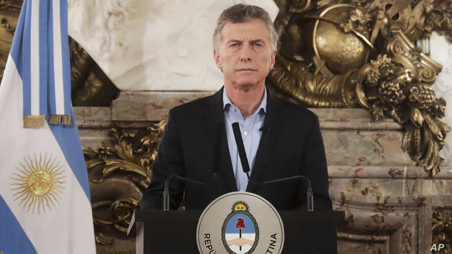 FILE - In this handout picture provided by Argentina Presidency, Argentina President Mauricio Macri pauses during a message to the nation at Government House in Buenos Aires, May 9, 2019.