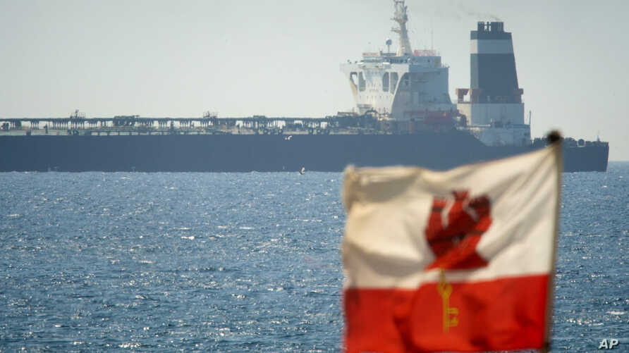A view of the Grace 1 super tanker in the British territory of Gibraltar, Thursday, July 4, 2019. Spain's acting foreign minister says a tanker stopped off Gibraltar and suspected of taking oil to Syria was intercepted by British authorities after a…