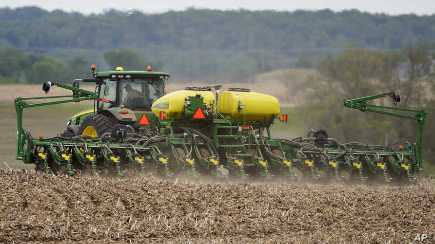 FILE - A farmer plants soybeans in a field in Springfield, Neb., Thursday, May 23, 2019. (AP Photo/Nati Harnik)