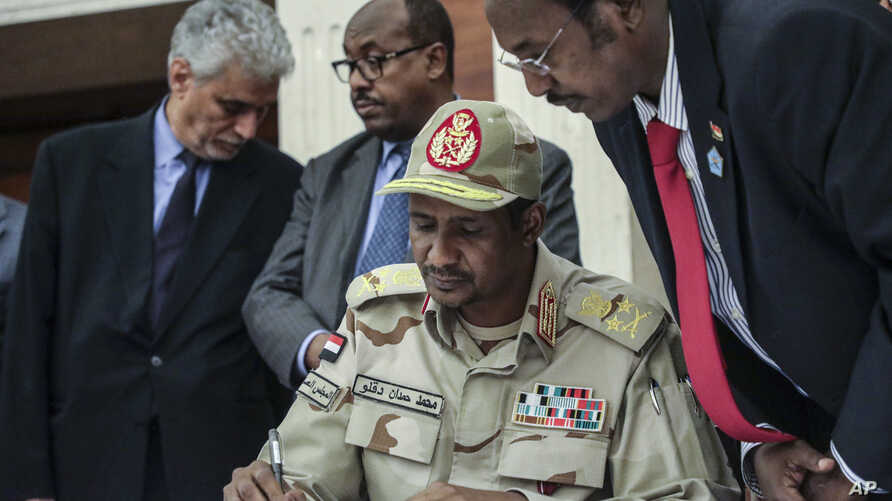 Gen. Mohammed Hamdan Dagalo signs a power sharing document with Sudan's pro-democracy movement and the ruling military council in Khartoum, Sudan, Wednesday, July 17, 2019. The two sides are still at work on a more contentious constitutional…