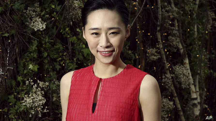 In this May 21, 2019, photo actress Wu Ke-xi poses for portrait photographs at the 72nd international film festival, Cannes, southern France. Wu Ke-xi wrote a screenplay inspired by the scandal involving U.S. producer Harvey Weinstein. The #MeToo…