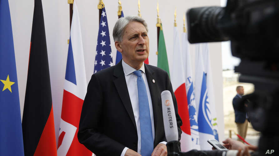 British Chancellor of the Exchequer Philip Hammond attends an interview during the G7 finance ministers and central bank governors meeting in Chantilly, near Paris, France, Thursday July 18, 2019. (Pascal Rossignol/Pool via AP)