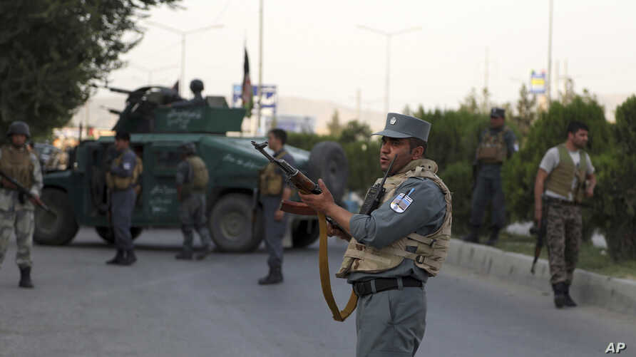 Afghan security personnel secure the site of an attack in Kabul, Afghanistan, July 28, 2019.