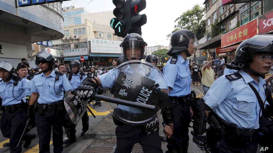 Hong Kong police push back protesters in Hong Kong Saturday, July 13, 2019. Several thousand people marched in Hong Kong on Saturday against traders from mainland China in what is fast becoming a summer of unrest in the semi-autonomous Chinese…