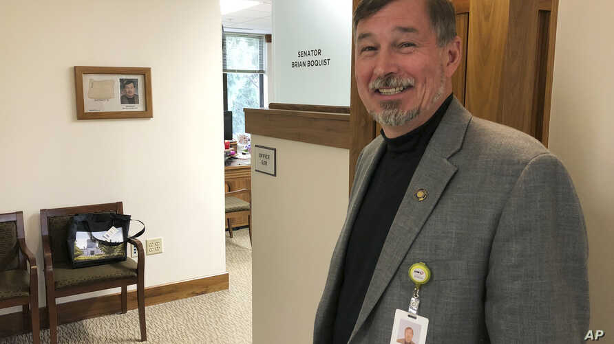 In this photo taken July 3, 2019, Oregon Sen. Brian Boquist poses outside his office in the Oregon State Capitol in Salem, Oregon., after an interview with The Associated Press.