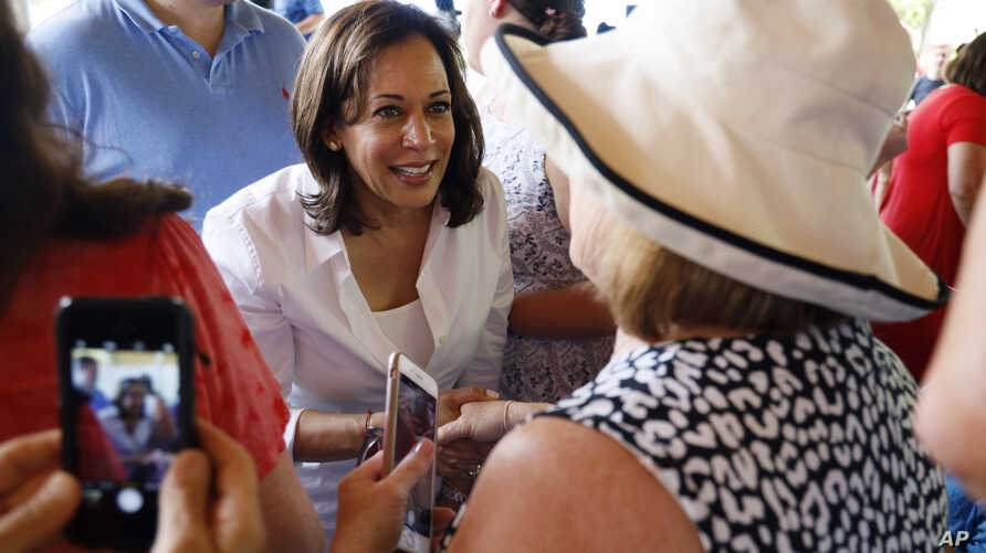 Democratic presidential candidate Sen. Kamala Harris greets local residents during the West Des Moines Democrats' annual picnic, Wednesday, July 3, 2019, in West Des Moines, Iowa. (AP Photo/Charlie Neibergall)