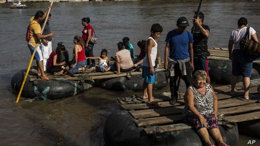 """Rafts loaded with passengers leave Tecun Uman, Guatemala, to cross the Suchiate River to reach Mexico, Tuesday, June 25, 2019. Mexico's President Andrés Manuel López Obrador says tightening of immigration controls has focused """"more than anything"""" on…"""