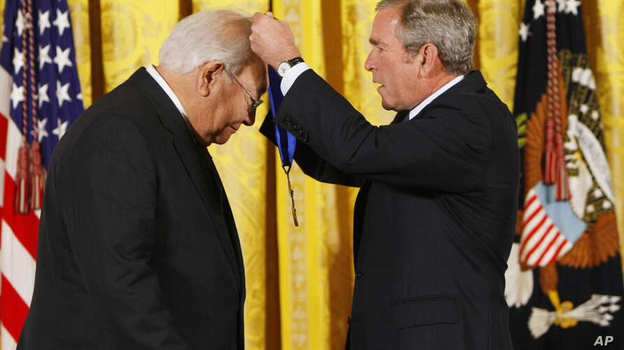 President Bush, right, presents the 2007 National Medal of Arts to author N. Scott Momaday of Oklahoma City, Thursday. Nov. 15, 2007, during a ceremony in the East Room of the White House in Washington.  (AP Photo/Gerald Herbert)