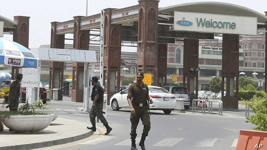 Pakistani security troops patrol outside the main terminal of Lahore's international airport in Pakistan, Wednesday, July 3, 2019. Police said that gunmen have shot and killed two people at a visitors' lounge outside the main terminal of Lahore's…