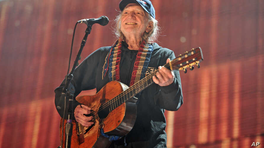 FILE - In this Sept. 19, 2015 file photo, Willie Nelson performs at Farm Aid 30 at FirstMerit Bank Pavilion at Northerly Island in Chicago. Nelson, John Mellencamp, Neil Young and Dave Matthews headline Farm Aid 2019 when the annual music and food…